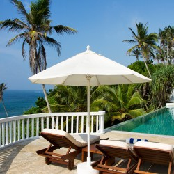 Pointe Sud Beach Villa pool and deck overlook a private beach