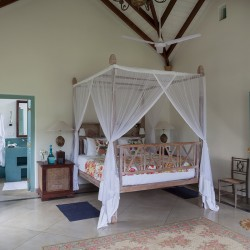 Traditional rattan and timber furniture create stunning bedrooms at Sisindu T Estate Habaraduwa