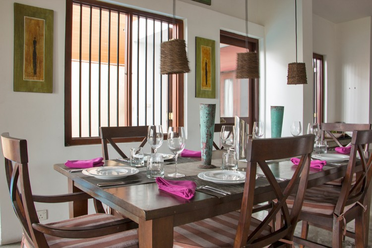Saldana Beach Villa offers formal dining catered by your private chef. Book the Colonial Style Beach Villa securely online.