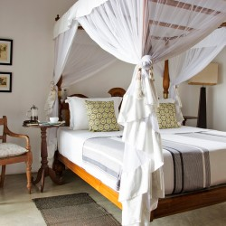 Airconditioned bedrooms are light and breezy atSaldana Beach Villa