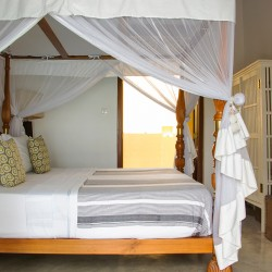 Saldana Beach Villa bedroom showing the traditional robe and ensuite bathroom