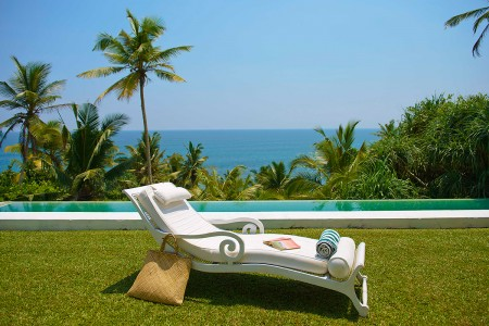 Relax poolside in a Bawa inspired sunlounge Pointe Sud Beach Villa