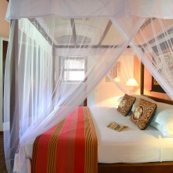 Pointe Sud Beach Villa Kingsized comfort beneath the mosquito nets