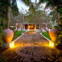Pointe Sud Beach Villa garden path at dusk, Villas for rent Sri Lanka