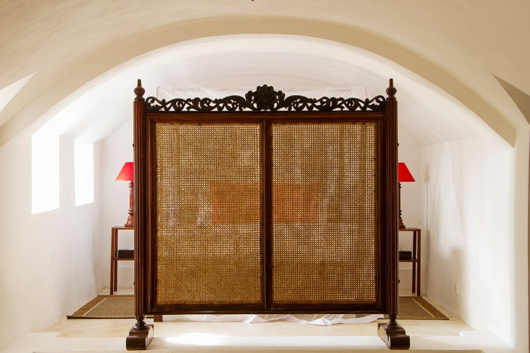A traditional room divider at Pointe Sud Beach Villa