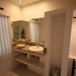 Modern styling in the ensuite bathrooms at The Well House Unawatuna
