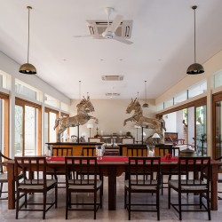 Serendipity Lake View Villa offers light flooded dining and lounge rooms with French doors on bothe sides of the rooms