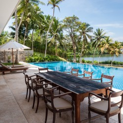 Poolside dining on the terrace at Serendipity Lake View Villa. Koggala lake fills the background.