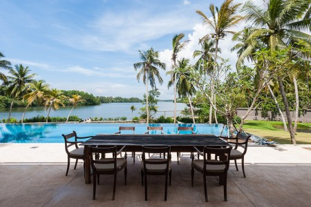 Serendipity Lake View Villa the large pool is dwarfed by Kogala lake in the background. Book Sri Lankan luxury villas online at Colonial Villas in Sri Lanka
