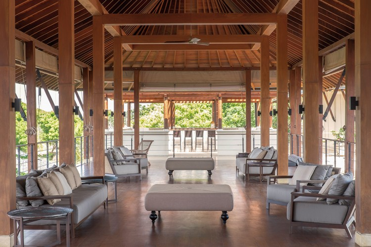 Ranawara Beach Villa comfortable lounge chairs are an ideal location to enjoy the views beneath the timber structure of the ambalama or pavillion