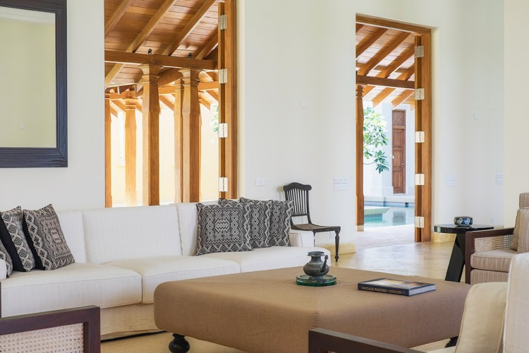 Ranawara Beach Villa is designed with sleek lines, minimalistic furniture and high timber doors