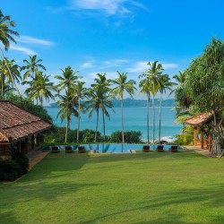From Lansiya Beach Villa Tangalle let your eyes be drawn out to sea through the coconut palms