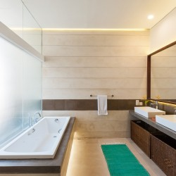 Serendipity Villa uses square lines, in sinks, bathtubs and mirrors to establish it's design credentials