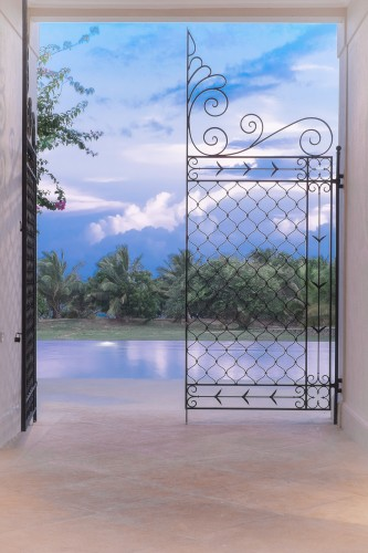 Ranawara Beach Villa fine steel gates draw your eyes to the great outdoors