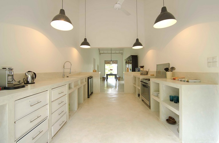 The long, spacious kitchen of Ivory House is the perfect way to prepare large and small meals alike
