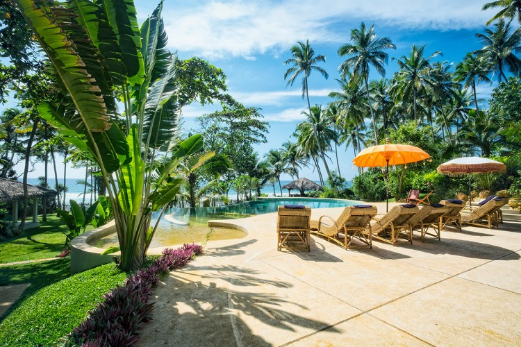 Meda Gedara Beach Villa is a great place to lounge poolside