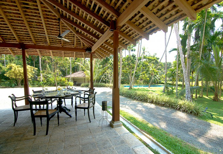 Outdoor dining overlooking the paddy fields at Ivory House Habaraduwa