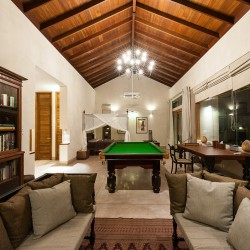 Serendipity Lake View Villa The Garden Suite's library, pool table and bedroom at night