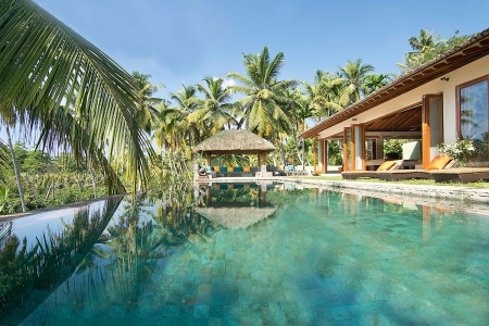 Villa Kumara's lap pool offers tropical views over the infinity edge