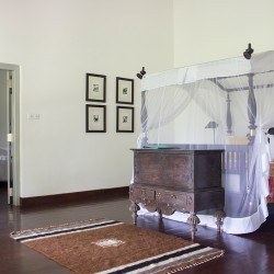 Mosquito nets blend seamlessly into the traditional bedroom furniture design at Ivory House