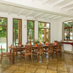 Skye Beach Villa Habaraduwa has a formal dining room with traditional timber table and dining chairs