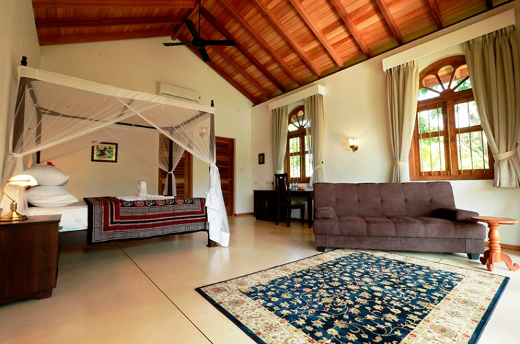Plush rugs, soft lounges and luxurious beds at Koggala House Lakeside Villa