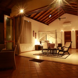 Koggala House Lakeside Villa allows you to open each bedroom with full length French doors