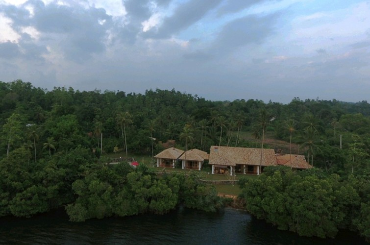 Koggala House Lakeside Villa beneath an approaching storm from an overhead drone