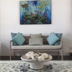 Reef House Beach Villa contemporary limed 2 seater couch and carved coffee table