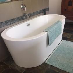 Enjoy a relaxing bath at Reef House Beach Villa