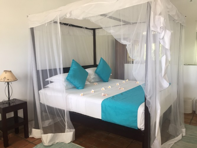 Reef House Beach Villa bedrooms offer contemporary, stylish four poster beds