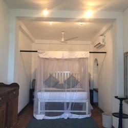 Reef House Beach Villa bedroom. Villas for rent in Sri Lanka