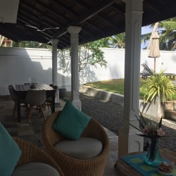 Reef House Beach Villa has shady areas for relaxation from the heat.