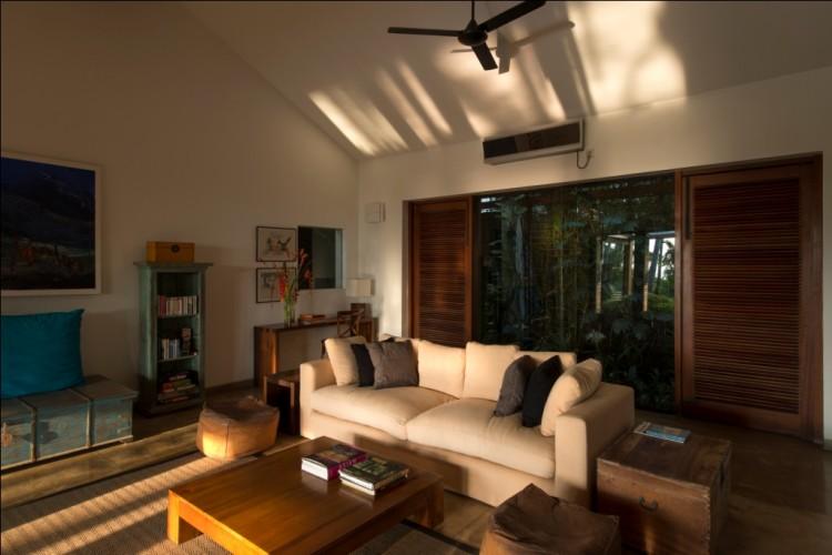 Maggona Beach Villa has ceiling fans to circulate air high above the lounges