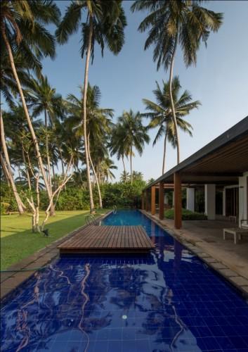 Maggona Beach Villa environmentally friendly design uses the pool to keep the house cool