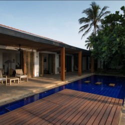 Maggona Beach Villa's pool is designed to be practical and visually striking with its decks and stepping stones