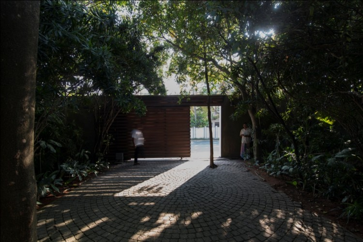 Circular patterns in the driveway paving contrast against the Maggona Beach Villa gate