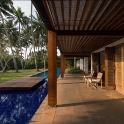 Maggona Beach Villa's design draws on the height of the coconuts, verandah pillars and the horizontal lines of the buildings length