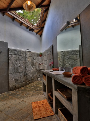 Villa Sepalika bathrooms have a partial roof to allow sunshine directly into the room
