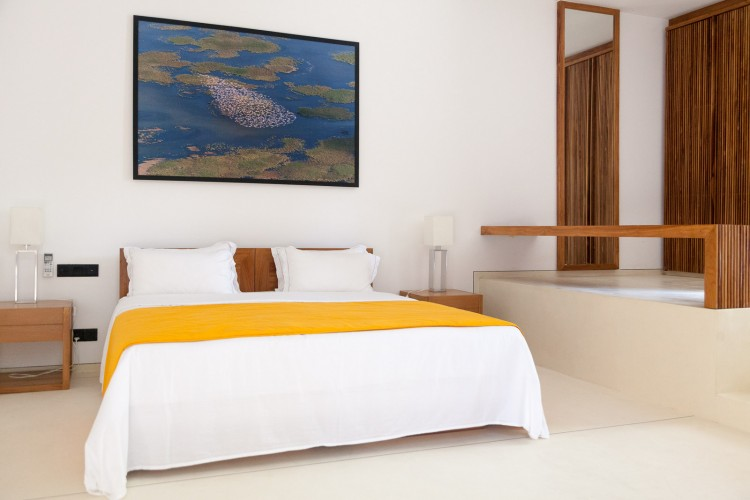 Light bright timber keeps bedrooms open and airyModern Luxury Villa Wambatu