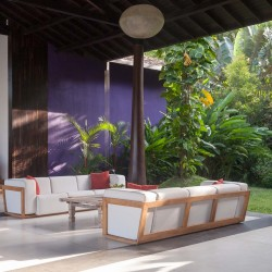 Outdoor lounge adjacent to the magnificent timber columns at Modern Luxury Villa Wambatu