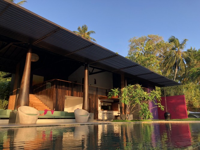 Modern Luxury Villa Wambatu appears suspended above the in-ground pool