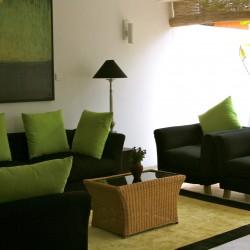 Black sofas with green designer cushions at Lake View Hikkaduwa