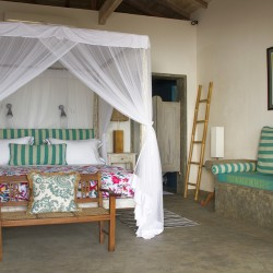 Nilaya Beach Villa Thalpe Bedroom featuring fourposter bed with mosquito net