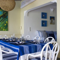 Bentwood white chairs of the dining area at Nilaya Beach Villa Thalpe