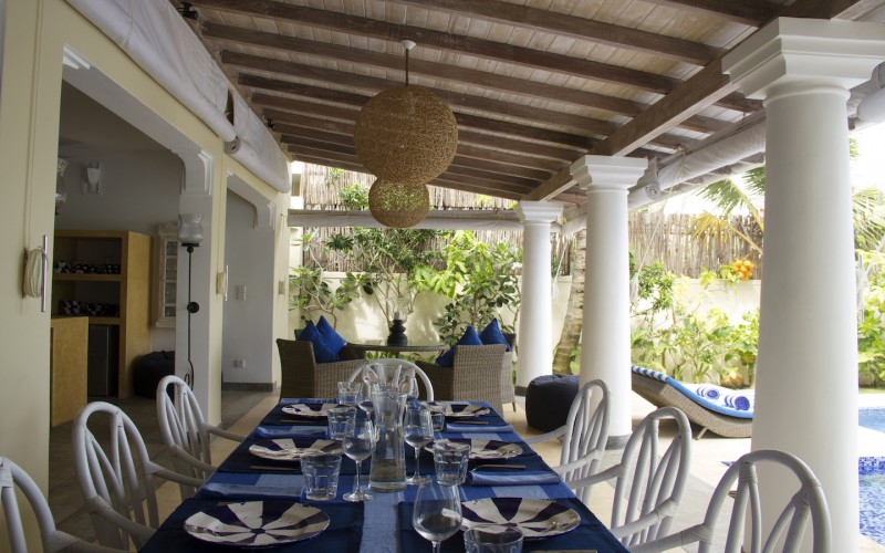 Strong columns support the verandah over the dining table Nilaya Beach Villa