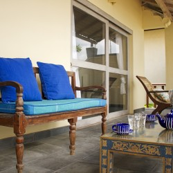 Nilaya Beach Villa Thalpe features traditional Sri Lankan timber furniture on the upstairs verandah