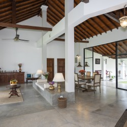 Villa Ronnaduwa's high timber ceilings and huge expanse of white walls highlight antique furnishings and historic photographs